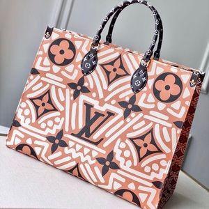 Louis Vuitton crafty onthego creme cameral